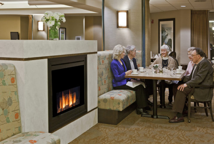 Cristwood Park residents dining together by fireplace