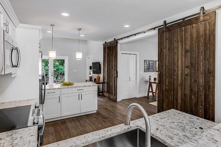 Spiritwood kitchen view with barn door